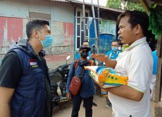 KNPI Kota Batam melaksanakan kegiatan bakti sosial (baksos) berupa pembagian sembako.